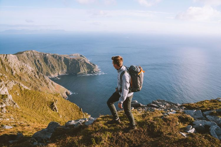 Exploring new parts of Ireland. Ireland Mountain VSCO Landscape Landscape Water Beauty In Nature Real People Sea Leisure Activity Lifestyles Scenics - Nature Rock Nature Rock - Object Tranquility Tranquil Scene One Person Solid Full Length Cloud - Sky Sky Beach Standing Outdoors