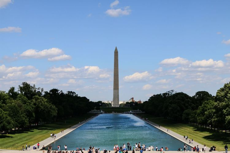 Reflecting Pool and Washington Monument in Washington DC. Architecture Blue Built Structure Capital Cities  City City Life Cloud Cloud - Sky Day Famous Place Grass Large Group Of People Leisure Activity Lifestyles Mixed Age Range Nature Outdoors Sky Tourism Tourist Travel Destinations Tree Vacations
