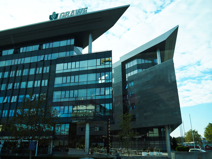 European Cities Eastern Europe Belgrade Serbia Balkans Europe Outdoors Street Photography Travel Destinations Building Exterior Architecture Built Structure City Day Building Cloud - Sky Low Angle View Modern Architecture No People Glass - Material Car Office Building Exterior Window Motor Vehicle Sky Office
