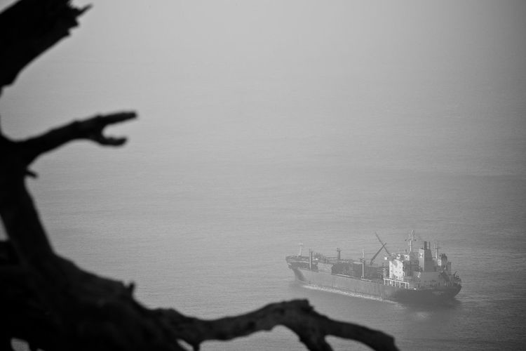 Boat sailing in sea during foggy weather
