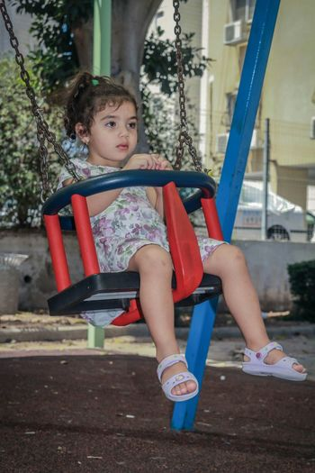 Cute baby girl swinging Child One Person Swing Playground Childhood Children Only Girl,cute, Pretty, Sister