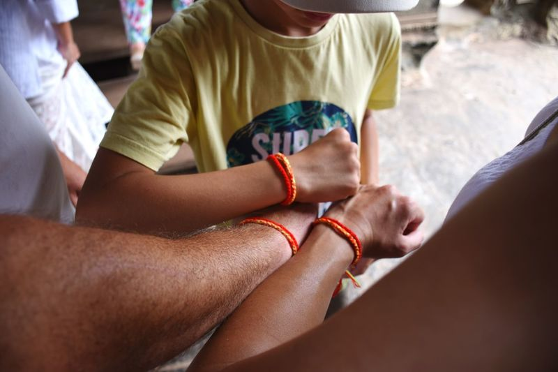 Lucky armbands, provided by monks in Angkor Wat. Armband Jewelry Family Still Life Arms No Face Selective Focus Red Culture Khmer Sunny Day Summertime Summer Young Men Cambodia ASIA Angkor Wat Monk  Bracelet Bouddhism Religion Holiday Historic Travel Destinations Siemreap This Is Family