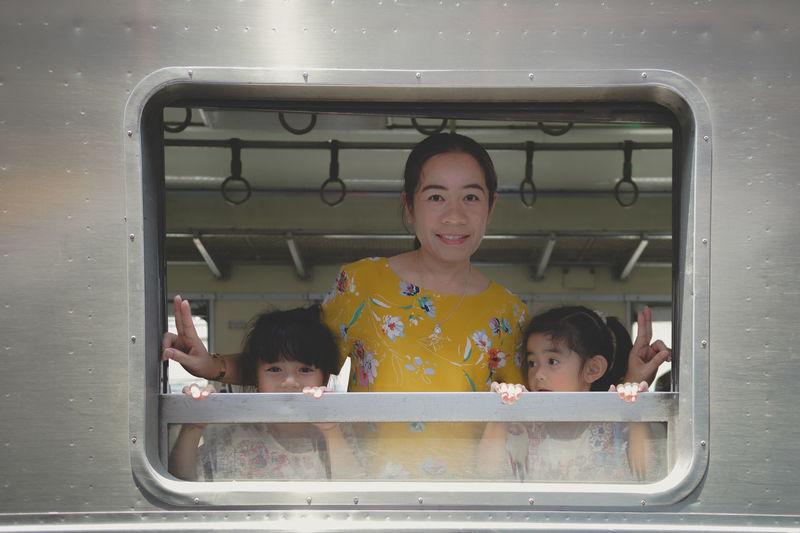Portrait of siblings in bus