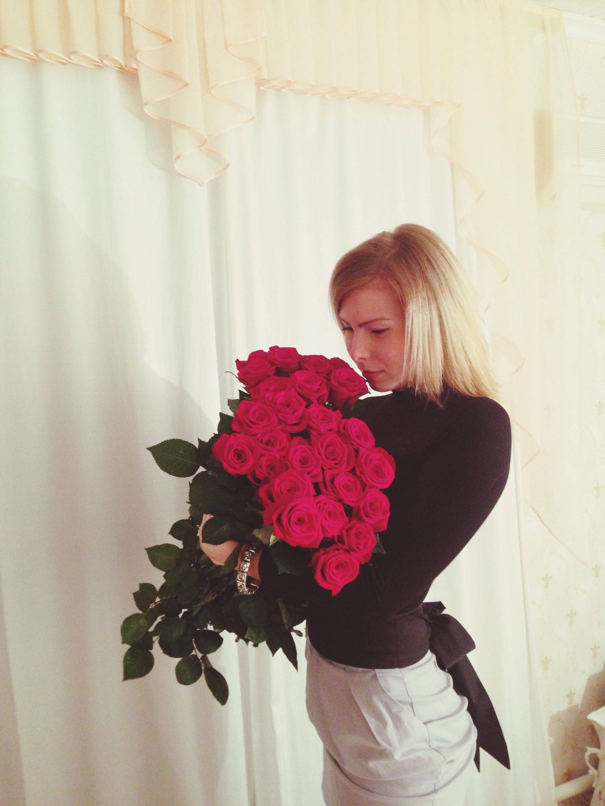 flower, lifestyles, person, casual clothing, leisure activity, young women, indoors, young adult, standing, front view, holding, girls, smiling, portrait, looking at camera, pink color, three quarter length, freshness