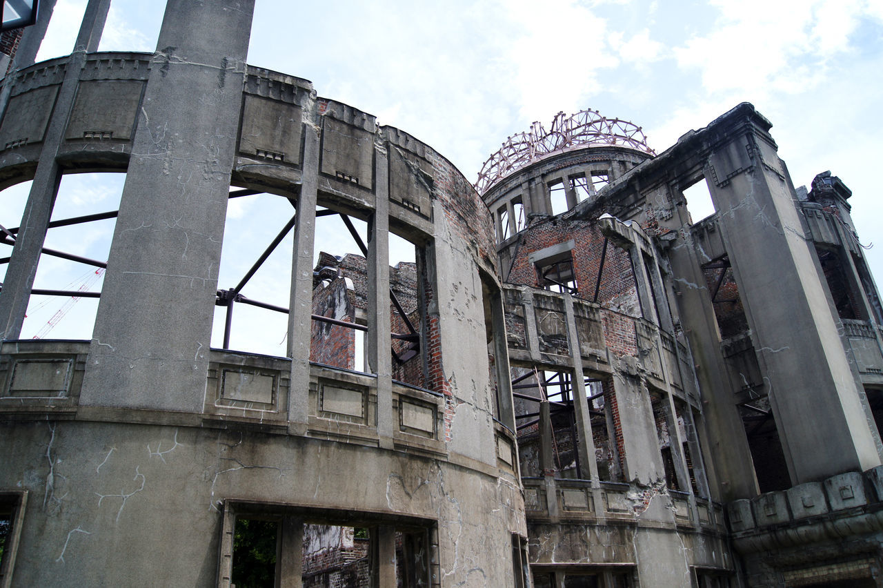 architecture, built structure, building exterior, low angle view, building, sky, no people, abandoned, day, window, city, nature, outdoors, damaged, industry, history, run-down, obsolete, old, the past, deterioration, ruined