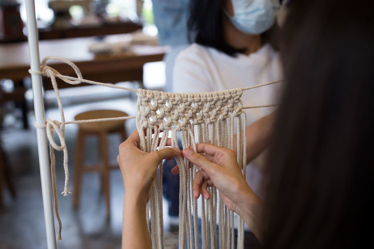 macrame workshop. Crafts Pattern Pieces Workshop Adult Art And Craft Close-up Clothing Craft Creativity Hand Handmade Holding Human Body Part Indoors  Lifestyles Macro Midsection One Person Pattern Real People Selective Focus Skill  Textile Women Working