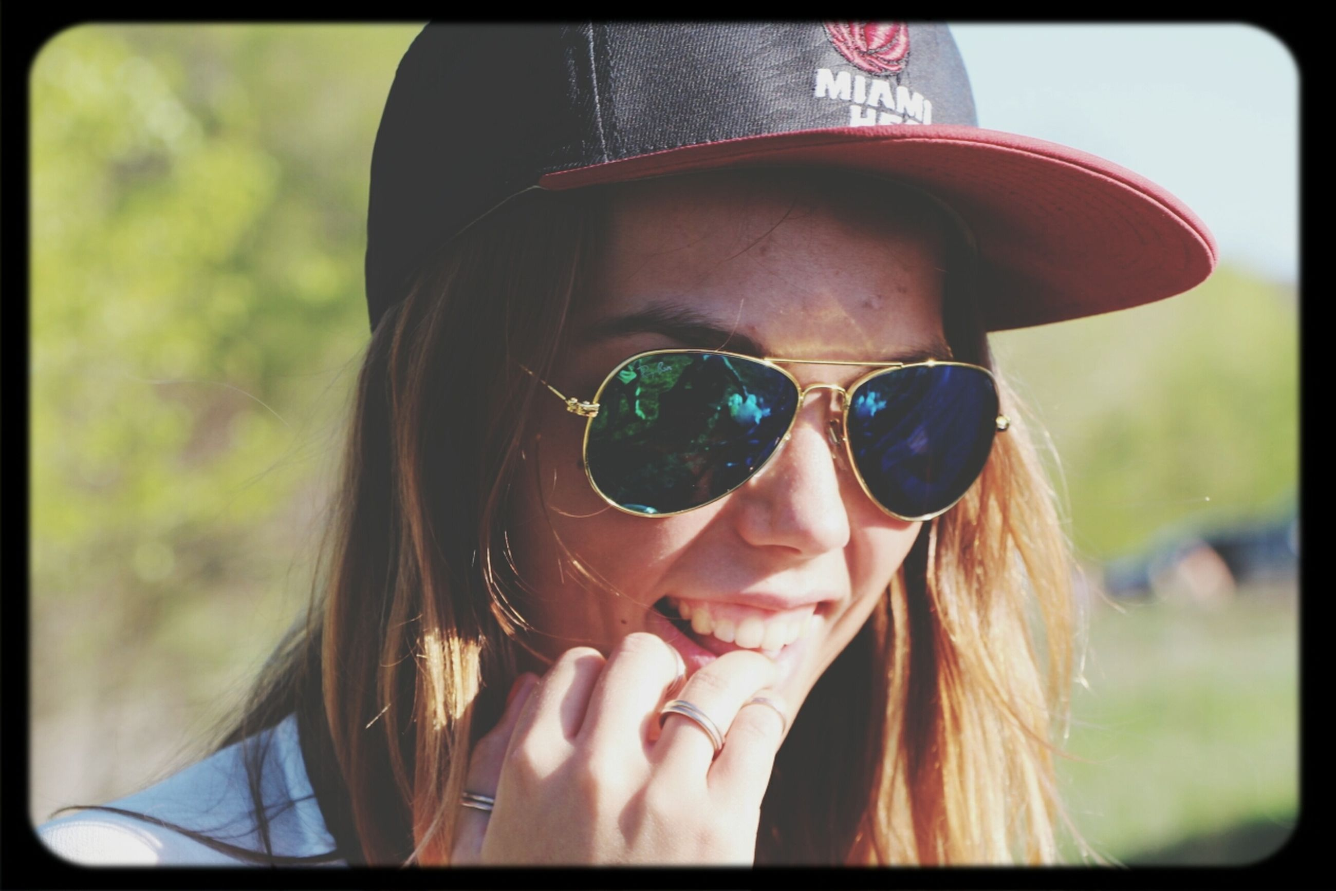 headshot, young adult, person, young women, lifestyles, portrait, looking at camera, leisure activity, sunglasses, head and shoulders, close-up, focus on foreground, front view, long hair, smiling, transfer print, auto post production filter