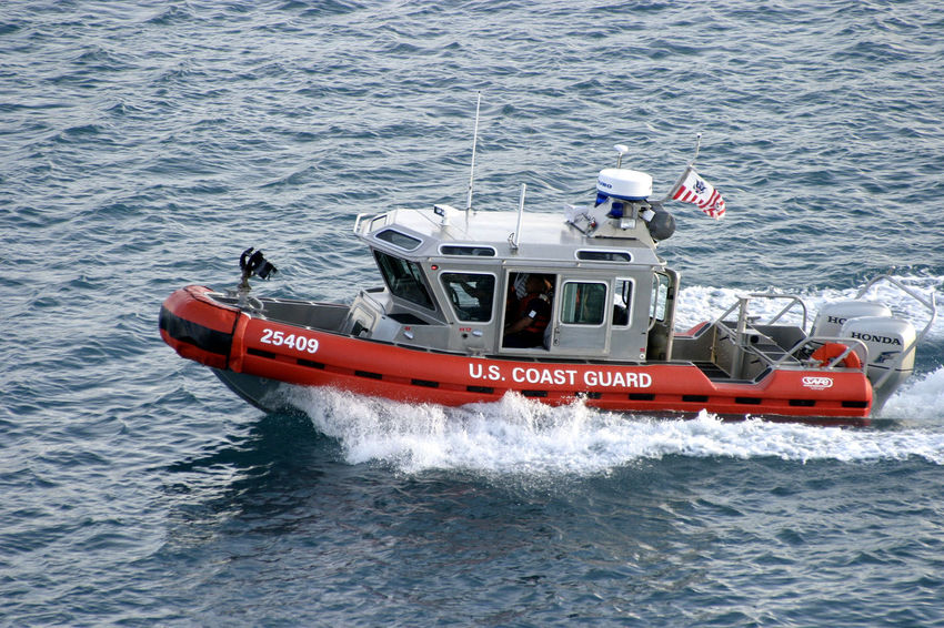 A US Coast Guard attack craft in Guam Harbour - Guam, South Pacific South Pacific Island US Coast Guard Adventure Day Guam Marianas Trench Mode Of Transport Motion Nature Nautical Vessel No People Outdoors Red Rescue Sailing Sea Transportation Wake - Water Water Wave