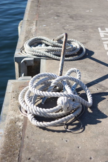 High angle view of rope tied on pier