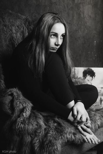 Portrait of young woman sitting in hair