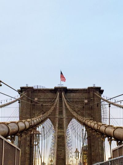 Architecture City Sky Flag Brooklyn Bridge / New York Day Outdoors Patriotism Clear Sky Connection No People Suspension Bridge Low Angle View Built Structure Bridge - Man Made Structure EyeEmNewHere