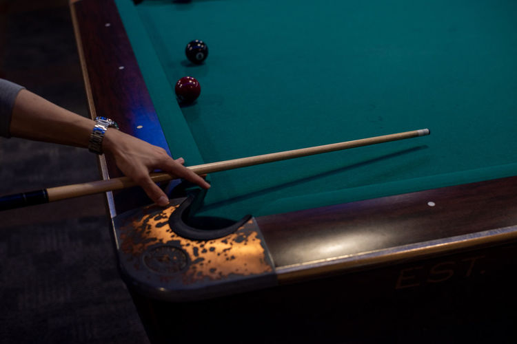 High angle view of person playing pool