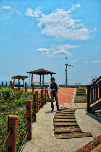 Man standing on walkway at miaoli cape of good hope