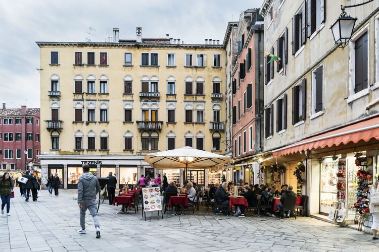 Walking along the narrow streets and canals of Venice, Italy Adult Architecture Building Exterior Built Structure Cafe Canal City Day Europe Gondola Italy, Landmarkbuildings Large Group Of People Men Outdoors People Real People Sidewalk Cafe Sky Travel Destinations Venetian Venice, Italy Walking Women