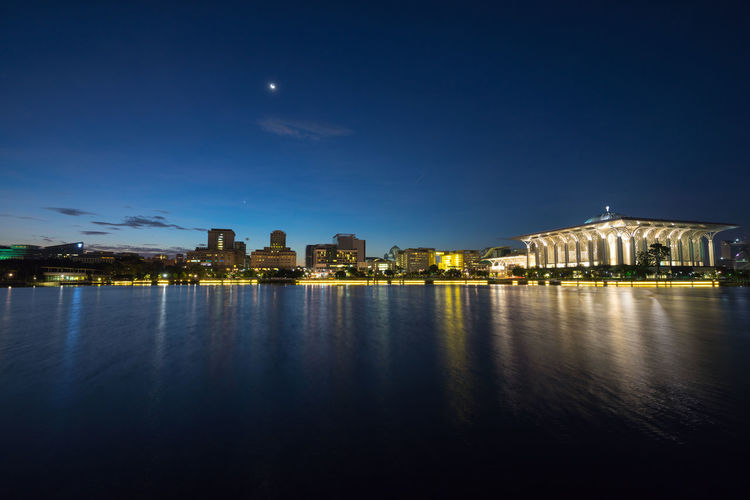 Illuminated buildings with waterfront at night