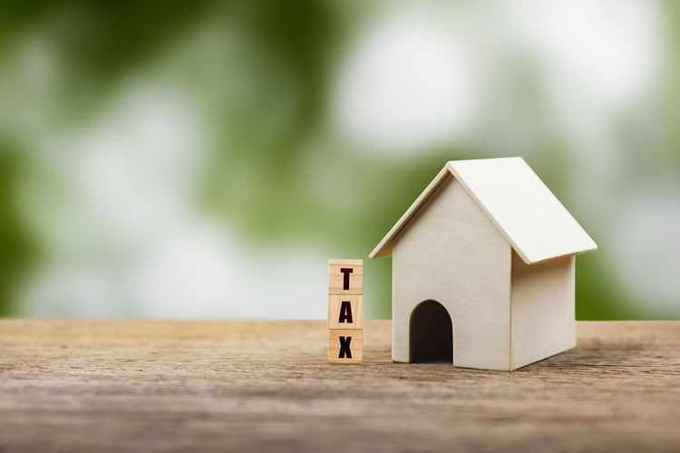 Close-up of small toy on table against building