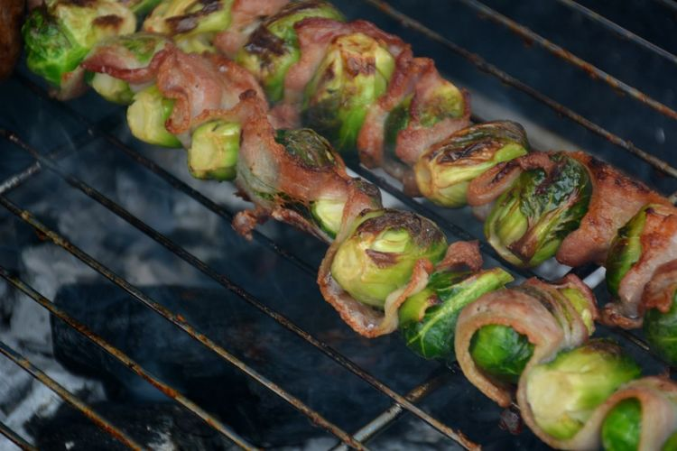 Close-up of bacon wrapped vegetables on barbecue grill