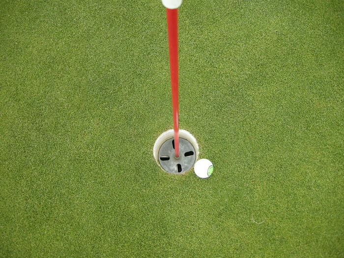 High Angle View Of Golf Ball By Hole At Course