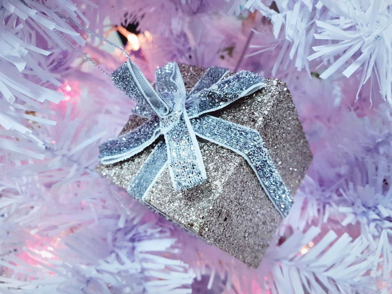 close-up, gift, bow, christmas decoration, celebration, christmas, decoration, tied bow, no people, holiday, ribbon, ribbon - sewing item, indoors, high angle view, event, pattern, nature, christmas ornament, gift box, box - container, wrapping paper, purple, silver colored