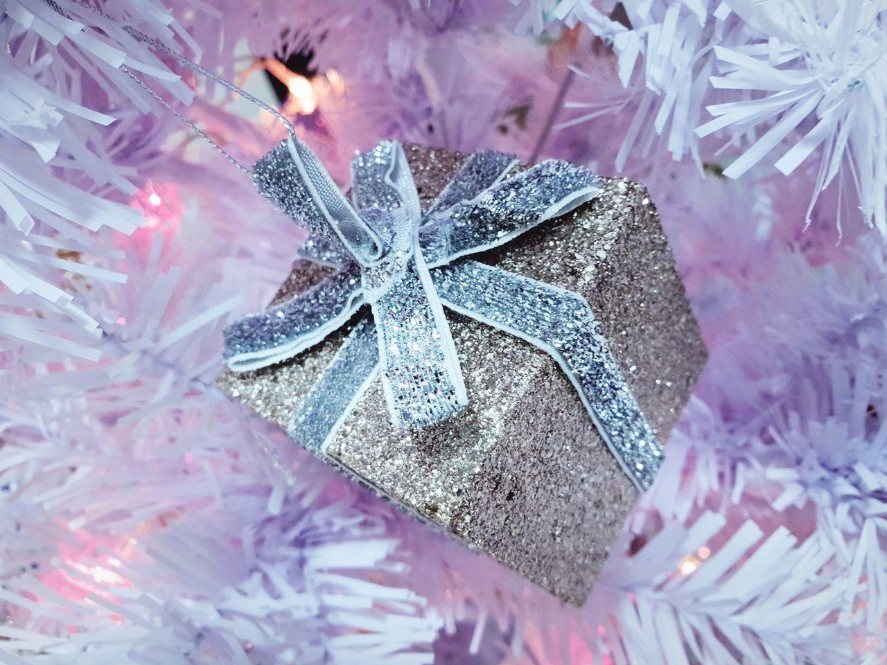 HIGH ANGLE VIEW OF CHRISTMAS DECORATIONS ON PURPLE