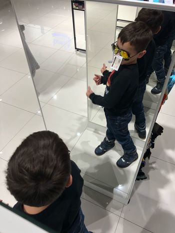 Shopping Shopping Looking In The Mirror Glasses Buyer Mirror Boy Childhood Child Males  Men Indoors  Casual Clothing Real People Standing Full Length