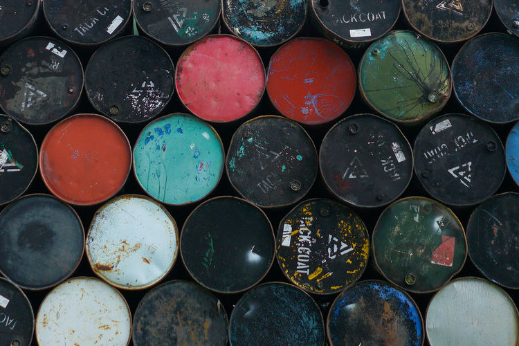 Full Frame Shot Of Stacked Oil Drums