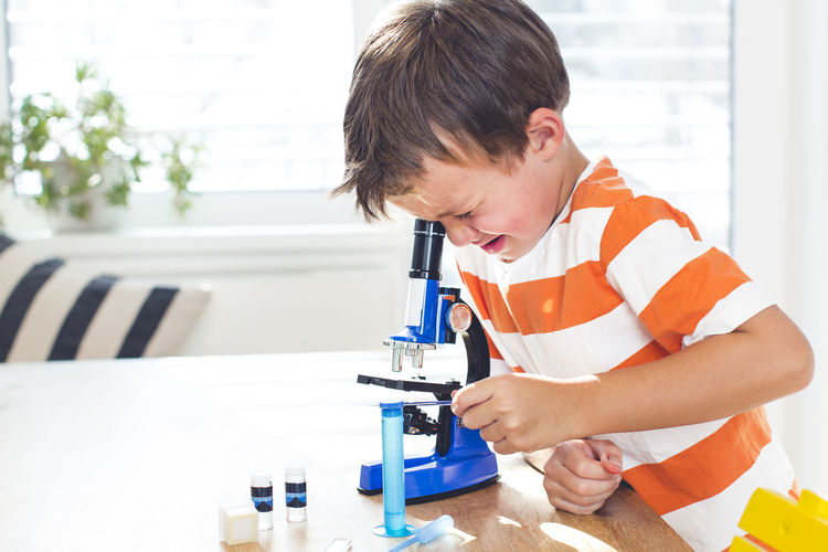 Boy doing science experiment at home