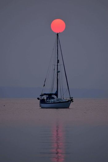 The Week On EyeEm Water Sunset Sailboat Nautical Vessel No People Beach Sea Red Outdoors Day Nature Horizon Over Water Sky