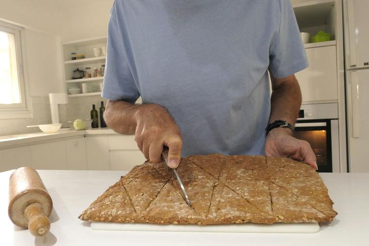Man preparing food on table at home