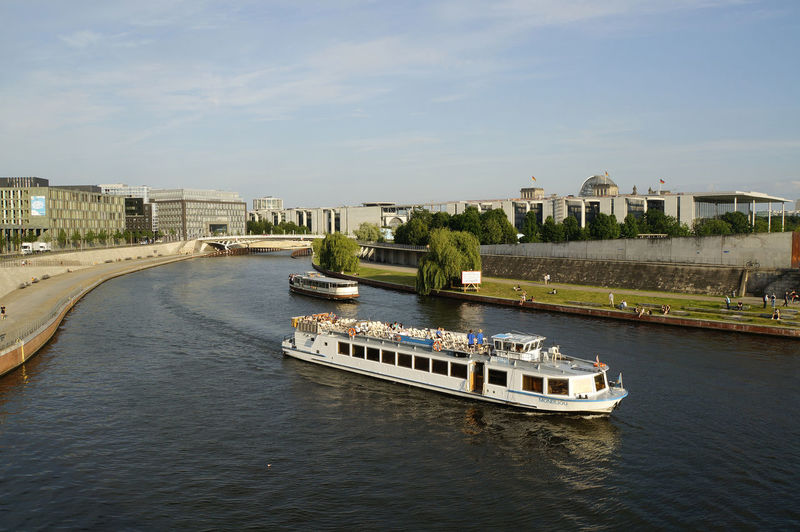 Architecture Berlin Mitte Bridge - Man Made Structure Built Structure Business Finance And Industry City Cityscape Day Nautical Vessel No People Outdoors Politics And Government Regierungsviertel River Sky Spree River Travel Destinations Urban Skyline Water
