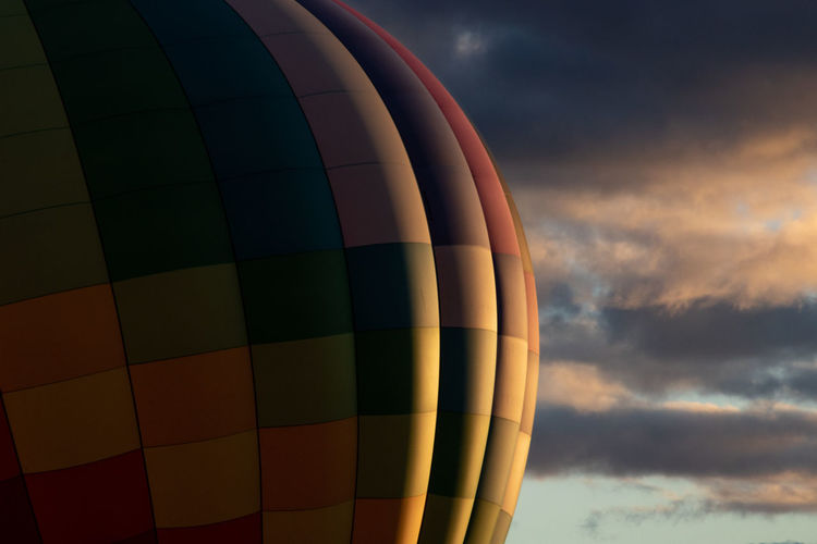 Low Angle View Of Hot Air Balloon Against Sky During Sunset