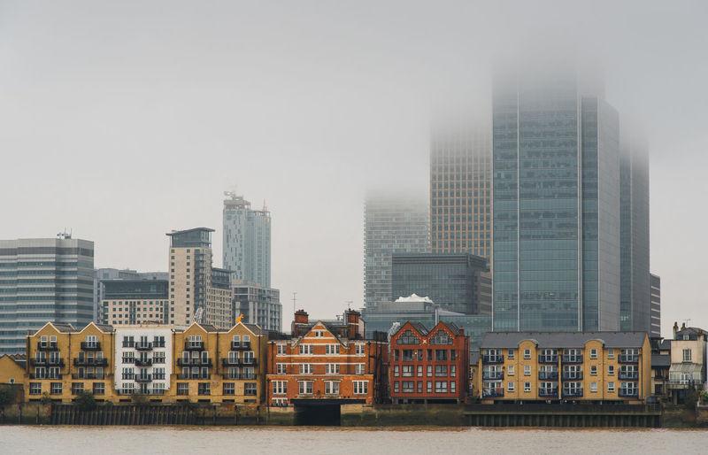 Modern office buildings in city against sky