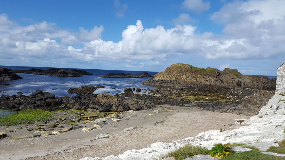 Seascape Scenics Outdoors Beauty In Nature No People Tranquil Scene Ballintoy Water Beach Sea Sand Blue Sky Horizon Over Water Cloud - Sky Landscape Calm Ocean Coastline Rock Formation Coast
