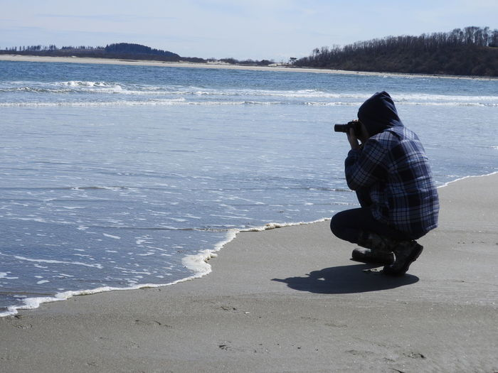 One Man On Beach One Man Photographing The Ocean One Man Alone On Beach Man On Beach Beauty In Nature Nature Photography Nature Spring In Massachusetts Atlantic Ocean Springtime Enjoying The View Enjoying Nature One Person Outdoors Sand Ocean Water Sea Full Length Beach Sky Sandy Beach