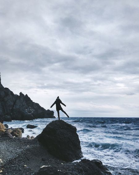 The Secret Spaces Sea Full Length Rock - Object Standing One Person Horizon Over Water Sky Cloud - Sky Water Nature Tranquil Scene Scenics Beauty In Nature Tranquility Silhouette Real People Outdoors Day Leisure Activity Men