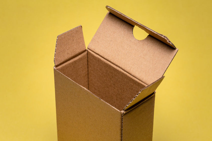 close up of small open cardboard pack Cardboard Box Cardboard Box Paper Container Box - Container Yellow Indoors  Brown Paper No People Studio Shot Close-up Still Life Brown Colored Background Package Gift Wrapped High Angle View Gift Box