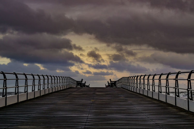 Saltburn pier on a cold windy morning. Teesside Saltburn Saltburn By The Sea Pier Saltburn Pier Cleveland Coast Yorkshire Yorkshire Coast England Europe European  North East England North East Sky Beauty In Nature Built Structure Diminishing Perspective Railing Long Footbridge Bridge - Man Made Structure Scenics - Nature Cloud - Sky The Way Forward