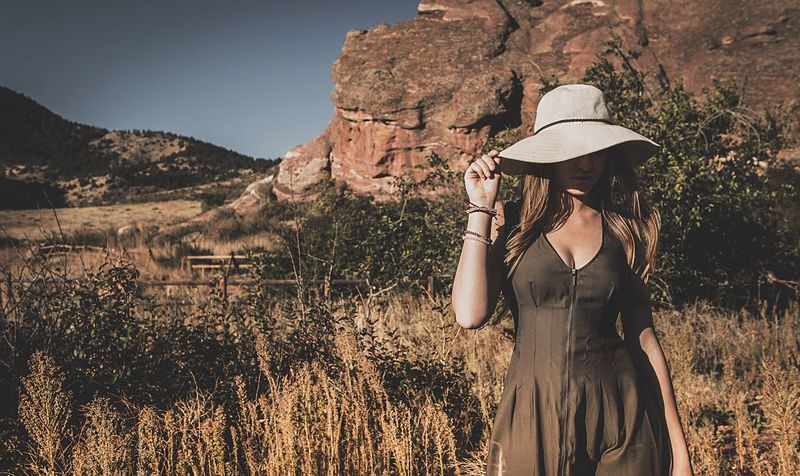Red Rocks Fashion Hat Nature Adventure Young Adult One Person Beauty In Nature Women Rock - Object Outdoors Tranquil Scene Standing Landscape Travel Lifestyles Adult Leisure Activity Mountain Grass Summer Scenics