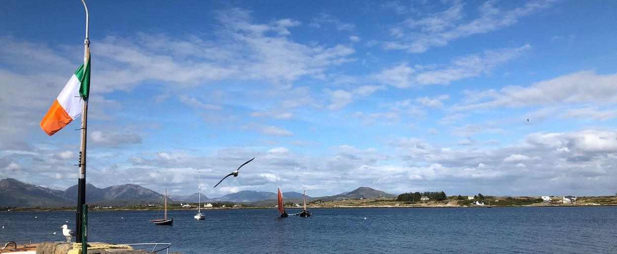 Roundstone, The Quay Ireland🍀 Water Sky Flag Cloud - Sky Nature Patriotism Beauty In Nature No People Lake Day Scenics - Nature Tranquil Scene Tranquility Mountain Waterfront Sailboat