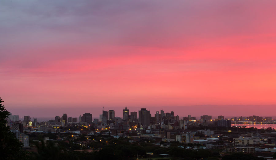 The skyline of Durban at dawn. Architecture Building Exterior Built Structure City Cityscape Cloud - Sky Clouds And Sky Illuminated Modern Night No People Outdoors Pink Residential Building Romantic Sky Sky Skyscraper Sunset Urban Skyline