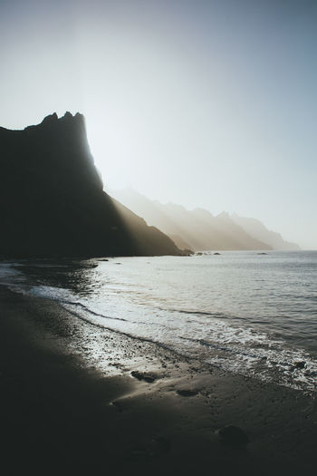Water Sky Land Beauty In Nature Sea Beach Mountain Tranquil Scene Tranquility Nature Scenics - Nature Clear Sky No People Day Outdoors Sand Rock Copy Space Non-urban Scene Sunset Sun Rays Blackbeach Tenerife Ocean Beachphotography