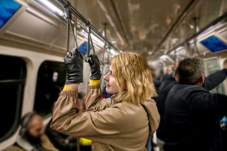Rear view of women standing in train