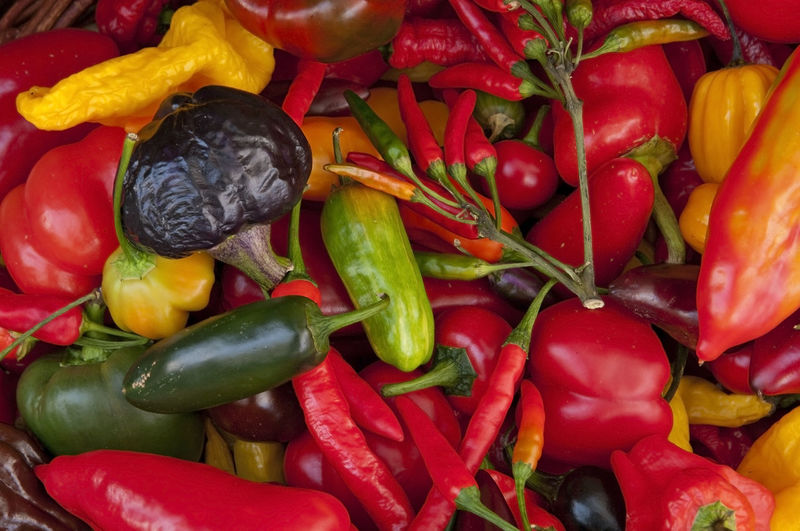 Full frame shot of chili and bell peppers for sale
