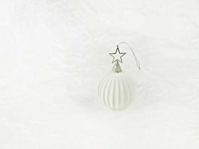 Close-Up Of Christmas Ornament Against White Background