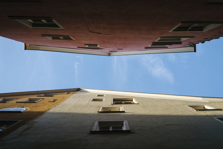 Directly below shot of building against sky