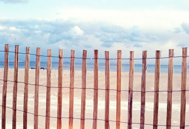 Brighton Beach Analogue Backgrounds Beach Brighton Beach Brooklyn Close-up Cloud - Sky Coney Island Fence Fencing Film Film Photography In A Row Nature No People NYC Outdoors Sand Sequence Sky Textured  Warm Colors Wood Wooden