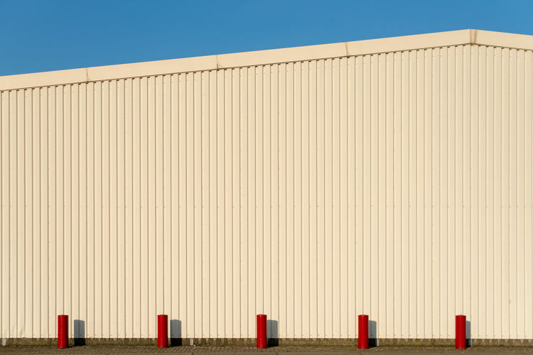 Hoffi99 Architecture No People Clear Sky Built Structure Sky Nature Day Building Exterior Copy Space Blue Sunlight Pattern Industry Outdoors Metal Side By Side Factory Wall - Building Feature In A Row Red
