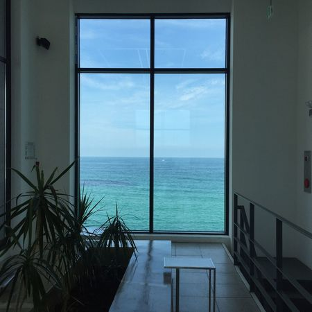 Window Sea Water Horizon Over Water No People Scenics Sky Indoors  Luxury Architecture Beauty In Nature Day Travel Destinations Blue Beach Water Reflections