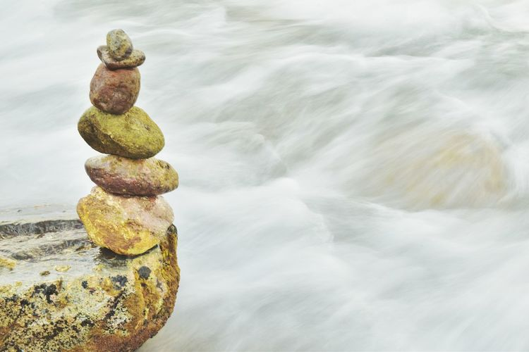 Stacked Stones Over River