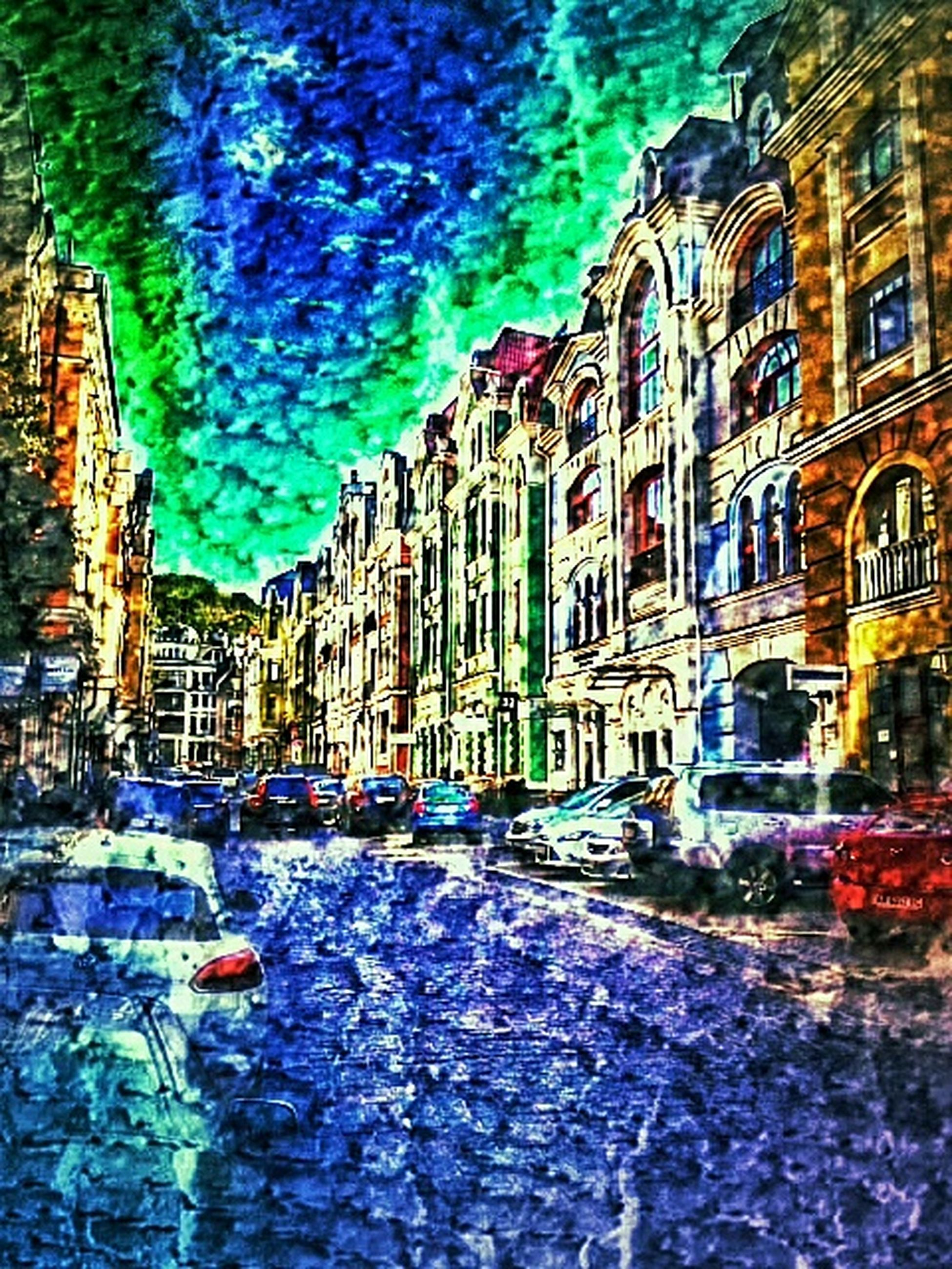 building exterior, architecture, built structure, street, city, cobblestone, residential building, the way forward, building, residential structure, multi colored, incidental people, sky, house, outdoors, city life, diminishing perspective, old town, illuminated, car